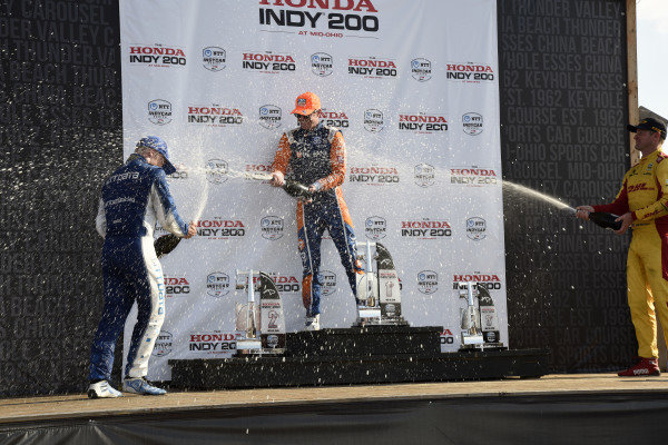 Felix Rosenqvist, Chip Ganassi Racing Honda, Scott Dixon, Chip Ganassi Racing Honda and Ryan Hunter-Reay, Andretti Autosport Honda spray champagne on the podium