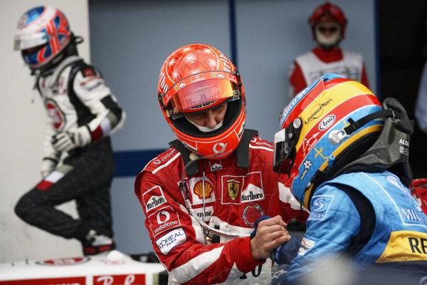 Michael Schumacher, 2nd position, congratulates Fernando Alonso on his victory.