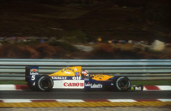 1992 Portuguese Grand Prix.Estoril, Portugal.25-27 September 1992.Nigel Mansell (Williams FW14B Renault) 1st position.Ref-92 POR 07.World Copyright - LAT Photographic