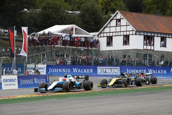 George Russell, Williams Racing FW42, leads Daniel Ricciardo, Renault R.S.19, and Kimi Raikkonen, Alfa Romeo Racing C38