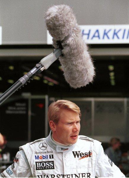 1999 Australian Grand Prix.Albert Park, Melbourne, Australia. 5-7 March 1999.Mika Hakkinen (McLaren Mercedes-Benz) is filmed in the paddock in Melbourne.World Copyright - Etherington/LAT Photographic