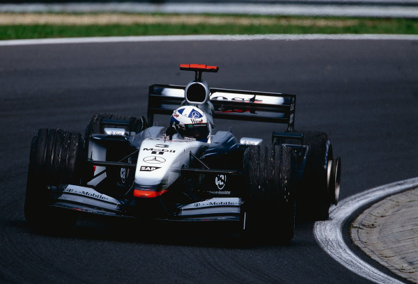 2002 Hungarian Grand Prix.Hungaroring, Budapest, Hungary. 16-18 August 2002.David Coulthard (McLaren MP4/17 Mercedes) with a punctured left rear tyre. He was still able to come home in 5th position.Ref-02 HUN 17.World Copyright - Bellanca/LAT Photographic