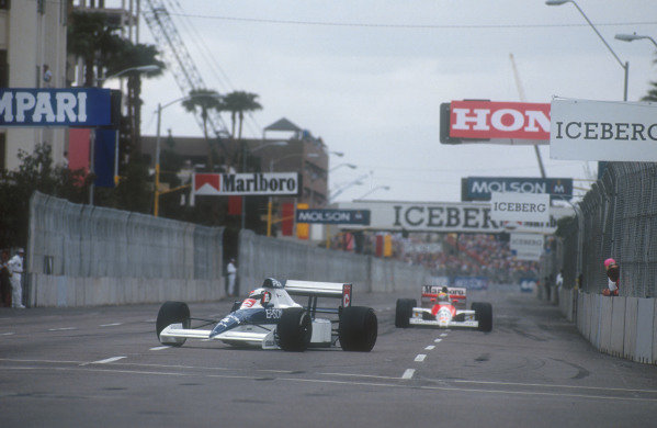 1990 United States Grand Prix.Phoenix, Arizona, USA.9-11 March 1990.Jean Alesi (Tyrrell 018 Ford) leads Ayrton Senna (Mclaren MP4/5B Honda). They finished in 2nd and 1st positions respectively.Ref-90 USA 09.World Copyright - LAT Photographic