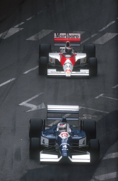 1990 Monaco Grand Prix.Monte Carlo, Monaco.25-27 May 1990.Jean Alesi (Tyrrell 019 Ford) 2nd position closely followed by Gerhard Berger (McLaren MP4/5B Honda) 3rd position.Ref-90 MON 13.World Copyright - LAT Photographic