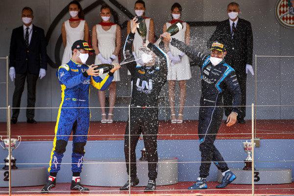 Felipe Drugovich (BRA, Uni-Virtuosi), Race Winner Guanyu Zhou (CHN, Uni-Virtuosi Racing) and Roy Nissany (ISR, DAMS) celebrate on the podium with the champagne