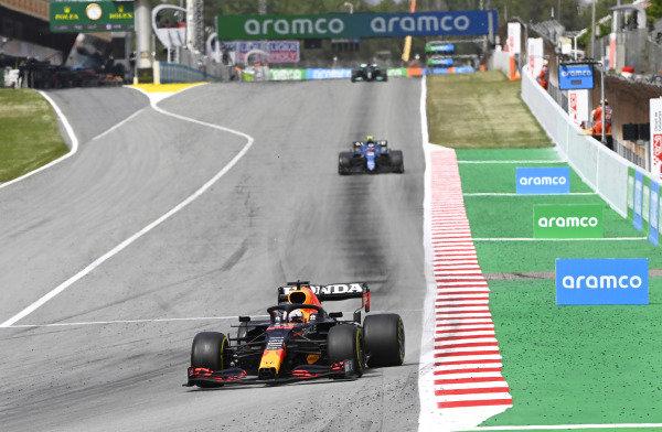 Max Verstappen, Red Bull Racing RB16B, leads Esteban Ocon, Alpine A521