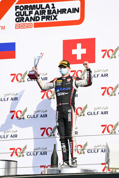 Louis Deletraz (CHE, CHAROUZ RACING SYSTEM) celebrates ont he podium with the trophy