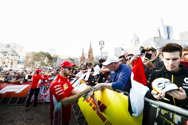 Charles Leclerc, Ferrari and Sebastian Vettel, Ferrari sign autographs for fans at the Federation Square event