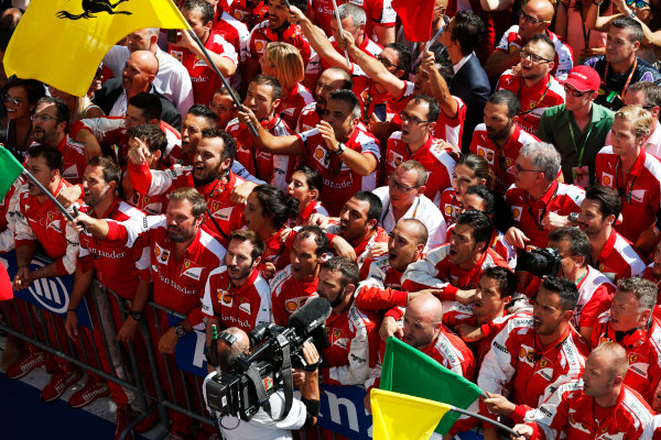 Hungaroring, Budapest, Hungary. Sunday 26 July 2015. The Ferrari team cheer for Sebastian Vettel, Ferrari, 1st Position, on the podium. World Copyright: Alastair Staley/LAT Photographic ref: Digital Image _79P0893