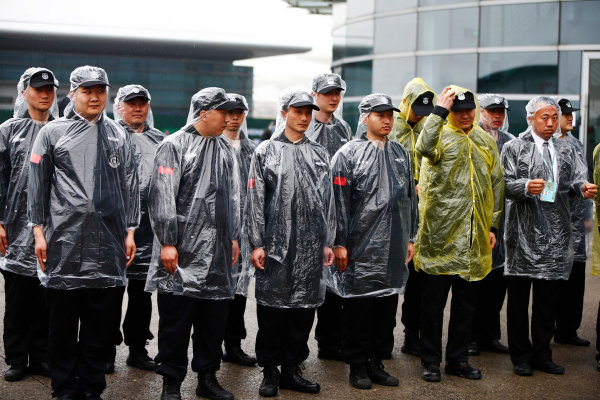 Shanghai International Circuit, Shanghai, China.  Friday 07 April 2017. Paddock security keep dry in the conditions. World Copyright: Andy Hone/LAT Images ref: Digital Image _ONZ4421