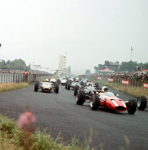 Nurburgring, Germany.5-7 August 1966.Jo Bonnier (Cooper T81 Maserati), Graham Hill (BRM P261) and Denny Hulme (Brabham BT20 Repco, number 4) lead the midfield at the start.Ref-3/2342.World Copyright - LAT Photographic