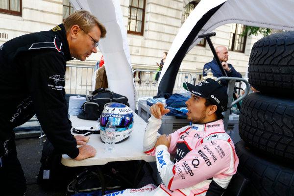 London, United Kingdom.  Wednesday 12 July 2017. Mika Hakkinen with Sergio Perez, Force India. World Copyright: Steven Tee/LAT Images  ref: Digital Image _O3I9484