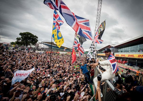 Silverstone, Northamptonshire, UK.  Sunday 16 July 2017. Lewis Hamilton, Mercedes AMG, 1st Position, celebrates victory with the British fans. World Copyright: Dunbar/LAT Images  ref: Digital Image _X4I8620