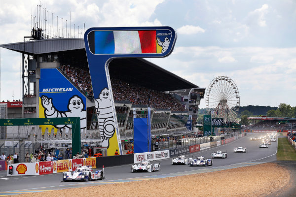 2014 Le Mans 24 Hours. Circuit de la Sarthe, Le Mans, France. Saturday 14 June 2014. Alexander Wurz (AUT), Stephane Sarrazin (FRA), Kazuki Nakajima (JPN) - Toyota Racing, Toyota TS 040 - Hybrid, leads Romain Dumas (FRA), Neel Jani (CHE), Marc Lieb (DEU) - Porsche Team, Porsche 919 - Hybrid  Photo: Sam Bloxham/LAT ref: Digital Image _SBL0729