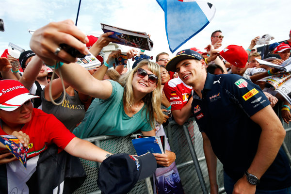Hockenheim, Germany. Saturday 30 July 2016. Max Verstappen, Red Bull, has a photo taken with a fan. World Copyright: Andy Hone/LAT Photographic ref: Digital Image _ONZ7527