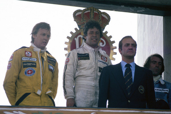 1978 Spanish Grand Prix.Jarama, Spain. 4th June 1978.Mario Andretti, Ronnie Peterson and Jacques Laffite on the podium with King Juan Carlos of Spain.World Copyright: Murenbeeld/LAT Photographic
