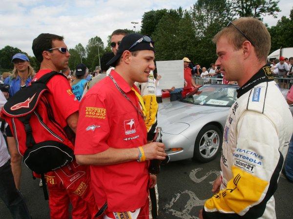 6 - 13 June 2004, LeMans, France Enge and Magnussen discuss the GTS pole battle. Copyright 2004, Richard Dole, USA LAT PHOTOGRAPHIC