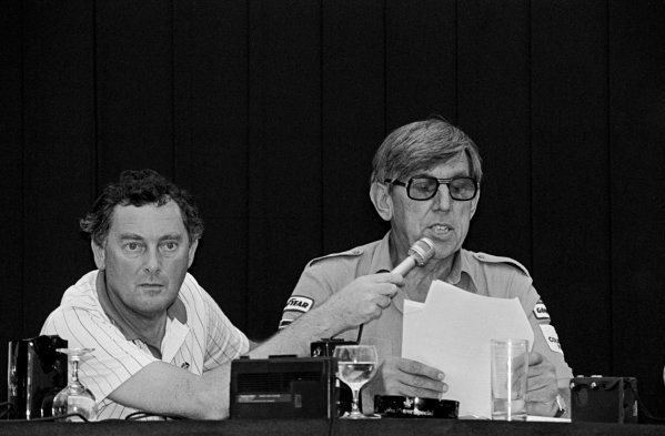 (L to R): Television commentator Barrie Gill (GBR) holds the microphone during a press conference given by Ken Tyrrell (GBR) Tyrrell Team Owner to announce his teamÕs decision to appeal their controversial exclusion from the Formula One World Championship. British Grand Prix, Brands Hatch, 22 July 1984.