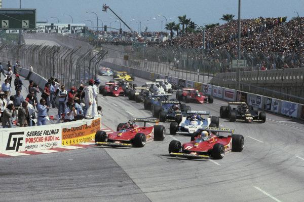 Long Beach, California, USA. 6 - 8 April 1979. Gilles Villeneuve and Jody Scheckter (Ferrari 312T4) lead at the start, action.  World Copyright: LAT Photographic. Ref: 79LB23.