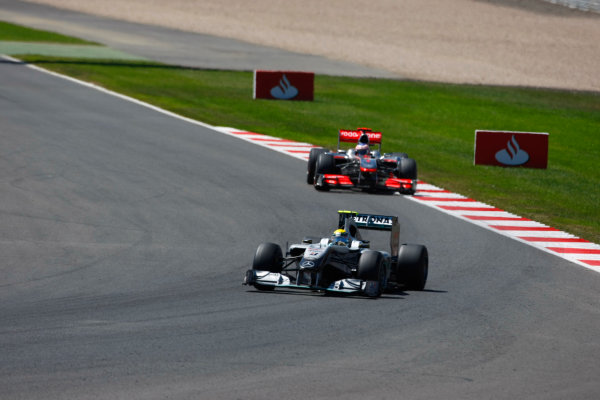 Silverstone, Northamptonshire, England11th July 2010Nico Rosberg, Mercedes GP W01, 3rd position, leads Jenson Button, McLaren MP4-25 Mercedes, 4th position. Action. World Copyright: Charles Coates/LAT Photographicref: Digital Image _26Y6064