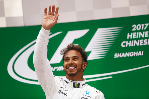Shanghai International Circuit, Shanghai, China.  Sunday 09 April 2017.  A beaming Lewis Hamilton, Mercedes AMG, 1st Position, celebrates on the podium. World Copyright: Steven Tee/LAT Images  ref: Digital Image _O3I5449