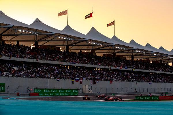 Yas Marina Circuit, Abu Dhabi, United Arab Emirates. Sunday 27 November 2016. Kimi Raikkonen, Ferrari SF16-H, leads Daniel Ricciardo, Red Bull Racing RB12 TAG Heuer, and Sebastian Vettel, Ferrari SF16-H. World Copyright: Zak Mauger/LAT Photographic ref: Digital Image _X0W9214