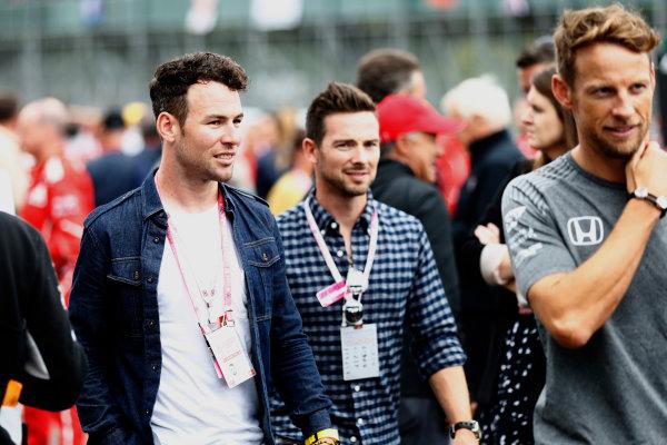 Silverstone, Northamptonshire, UK.  Sunday 16 July 2017. Cyclist Mark Cavendish and Jenson Button. World Copyright: Glenn Dunbar/LAT Images  ref: Digital Image _31I6420