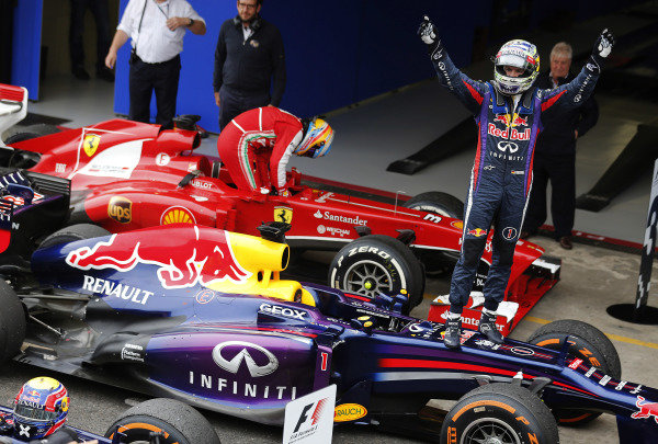 Interlagos, Sao Paulo, Brazil. Sunday 24th November 2013.  Sebastian Vettel, Red Bull Racing, 1st position, celebrates in Parc Ferme as Fernando Alonso, Ferrari, 3rd position, climbs out of his car. World Copyright: Steven Tee/LAT Photographic. ref: Digital Image _14P1425