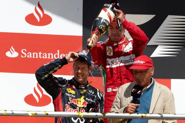 Hockenheimring, Hockenheim, Germany 22nd July 2012 Fernando Alonso, Ferrari, 1st position, and Sebastian Vettel, Red Bull Racing, 2nd position, on the podium with Niki Lauda. World Copyright: Steve Etherington/LAT Photographic ref: Digital Image HC5C5998 copy