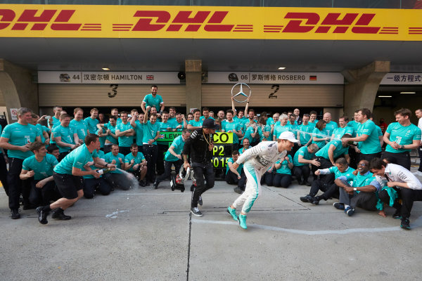 Shanghai International Circuit, Shanghai, China. Sunday 12 April 2015. Lewis Hamilton, Mercedes AMG, 1st Position, and Nico Rosberg, Mercedes AMG, 2nd Position, celebrate another victory with their team mates. World Copyright: Steve Etherington/LAT Photographic. ref: Digital Image SNE11416