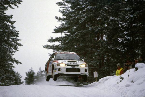 1998 World Rally Championship.Swedish Rally, Sweden. 6-8 February 1998.Tommi Makinen/Risto Mannisenmaki (Mitsubishi Lancer Evo4), 1st position.World Copyright: LAT PhotographicRef: 35mm transparency 98RALLY01
