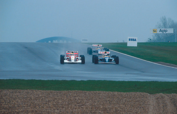 1993 European Grand Prix. Donington Park, England. 9-11 April 1993. Ayrton Senna (McLaren MP4/8 Ford) passes Alain Prost (Williams FW15C Renault) down the inside on the entry to the Melbourne Hairpin on the openning lap. Damon Hill (Williams FW15C Renault) follows behind.  Ref-93 EUR 13. World Copyright - LAT Photographic
