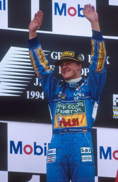 1994 European Grand Prix.Jerez, Spain.14-16 October 1994.Michael Schumacher (Benetton Ford) celebrates 1st position on the podium.Ref-94 EUR 06.World Copyright - LAT Photographic