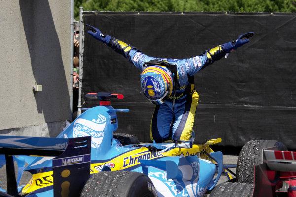 Fernando Alonso celebrates victory in parc fermé in his unique way.