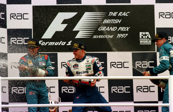 1997 British Grand Prix. Silverstone, England. 11-13 July 1997. Jacques Villeneuve (Williams Renault), Jean Alesi and Alexander Wurz (both Benetton Renault) after finishing in 1st, 2nd and 3rd positions respectively. World Copyright - LAT Photographic