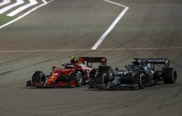 Carlos Sainz, Ferrari SF21, battles with Lance Stroll, Aston Martin AMR21