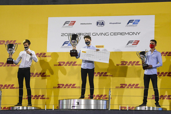F3 Championship Winner Oscar Piastri (AUS, PREMA RACING), 2nd place Theo Pourchaire (FRA, ART GRAND PRIX) and 3rd position Logan Sargeant (USA, PREMA RACING) celebrate on the podium with the trophy