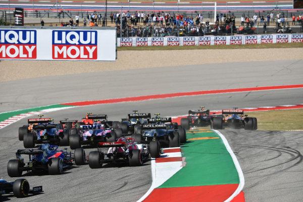 Valtteri Bottas, Mercedes AMG W10, leads Sebastian Vettel, Ferrari SF90, Max Verstappen, Red Bull Racing RB15, Lewis Hamilton, Mercedes AMG F1 W10, Charles Leclerc, Ferrari SF90, and the rest of the field away at the start as Alexander Albon, Red Bull RB15, and Carlos Sainz Jr., McLaren MCL34, make contact