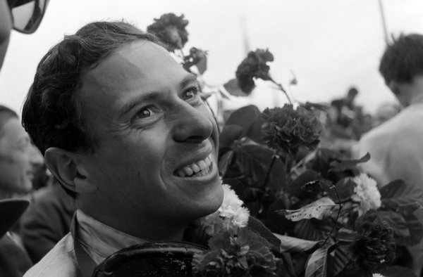 Race winner Jim Clark with the flowers he received on the podium.