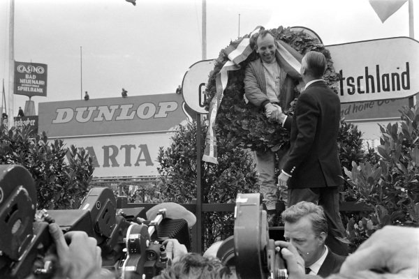 John Surtees, 1st position, on the podium.