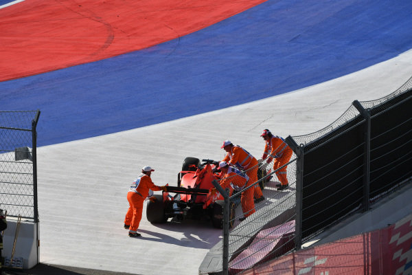 Marshals move the car of Sebastian Vettel, Ferrari SF90, off the circuit