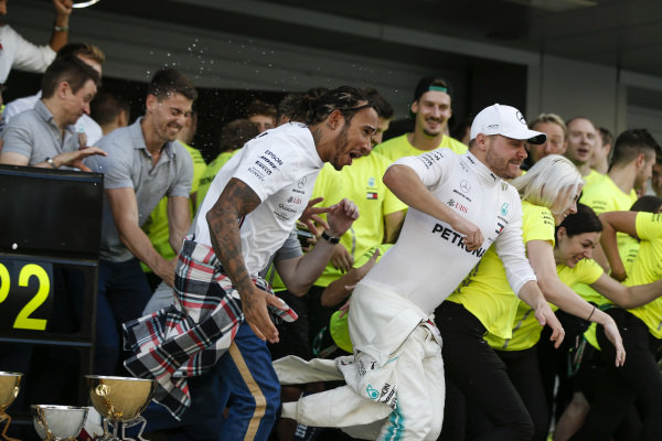 Valtteri Bottas, Mercedes AMG F1, 2nd position, Lewis Hamilton, Mercedes AMG F1, 1st position, and the Mercedes team celebrate a perfect result