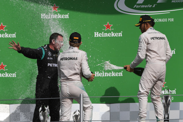 Nico Rosberg (GER) Mercedes AMG F1 and Lewis Hamilton (GBR) Mercedes AMG F1 celebrate on the podium with Tom Walton (GBR) Mercedes AMG F1 Engineer and the champagne at Formula One World Championship, Rd19, Mexican Grand Prix, Race, Circuit Hermanos Rodriguez, Mexico City, Mexico, Sunday 30 October 2016.