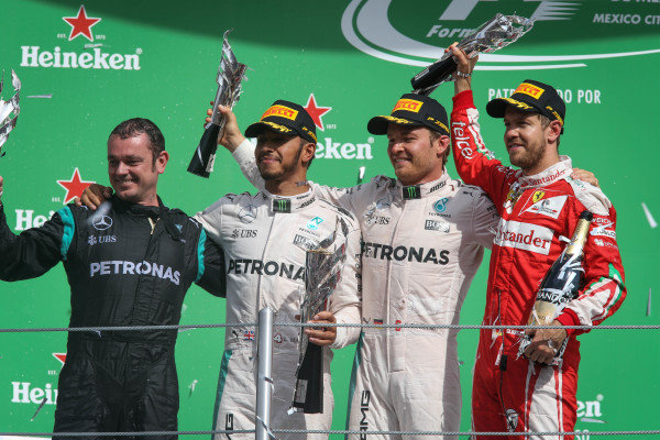 (L to R): Tom Walton (GBR) Mercedes AMG F1 Engineer, Nico Rosberg (GER) Mercedes AMG F1, Lewis Hamilton (GBR) Mercedes AMG F1 and Sebastian Vettel (GER) Ferrari celebrate on the podium with the trophies at Formula One World Championship, Rd19, Mexican Grand Prix, Race, Circuit Hermanos Rodriguez, Mexico City, Mexico, Sunday 30 October 2016.