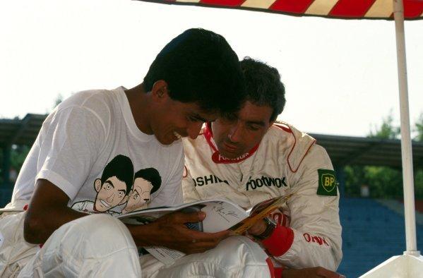 Aguri Suzuki (JPN) Footwork chats with teammate Michele Alboreto (ITA).German Grand Prix, Hockenheim, Germany, 26 July 1992.DIGITAL IMAGE