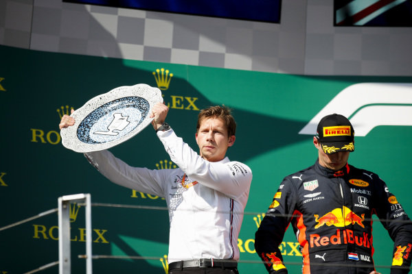 Matt Deane, Chief Mechanic, Mercedes AMG, receives the Constructors trophy for Mercedes alongside Max Verstappen, Red Bull Racing, 2nd position
