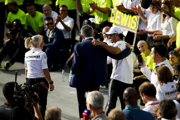Lewis Hamilton, Mercedes AMG F1, 1st position, celebrates with Actor Rowan Atkinson and his team