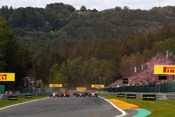 Sebastian Vettel, Ferrari SF71H, overtakes Lewis Hamilton, Mercedes AMG F1 W09, at the start. Behind, Esteban Ocon, Racing Point Force India VJM11, leads Sergio Perez, Racing Point Force India VJM11.
