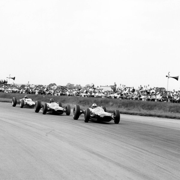 1963 British Grand Prix.Silverstone, England.18-20 July 1963.Jack Brabham leads Dan Gurney (both Brabham BT7 Climax's) and Bruce McLaren (Cooper T66 Climax).Ref-20426.World Copyright - LAT Photographic