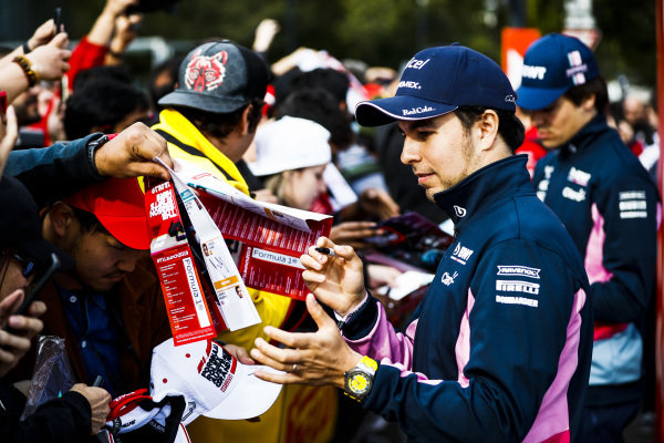 Sergio Perez, Racing Point signs a autograph for a fan at the Federation Square event